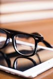 Glasses and a tablet Royalty Free Stock Photography