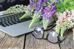 Glasses on tablet  and flowers Stock Image