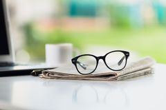 Glasses on tablet. Break broadsheet business coffee communication computer Royalty Free Stock Photos