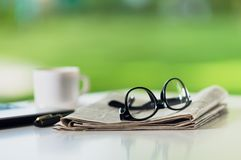 Glasses on tablet. Break broadsheet business coffee communication computer Royalty Free Stock Image
