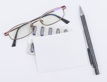 Glasses and tablets. White sheet with a ballpoint. Pen stock photo