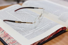 Glasses on the Talmud. Background Torah study Stock Photo