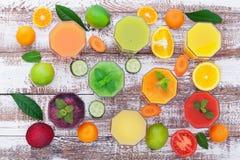 Glasses of tasty fresh juice, on wooden desk. royalty free stock photos
