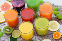Glasses of tasty fresh juice, on wooden desk. stock photography
