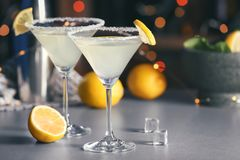 Glasses with tasty lemon drop martini cocktail. On table royalty free stock images