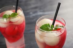 Glasses with tasty melon and watermelon ball drinks. On dark table stock photo