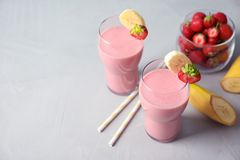 Glasses with tasty strawberry smoothie. On table royalty free stock photos