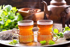 Glasses of tea with teapot Royalty Free Stock Images