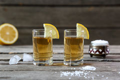 Glasses of tequila with lemon and salt Royalty Free Stock Photography
