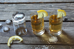 Glasses of tequila with lemon and salt Stock Photography