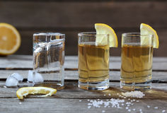 Glasses of tequila with lemon and salt Stock Photo