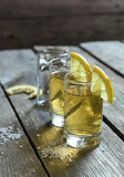 Glasses of tequila with lemon and salt Royalty Free Stock Photos