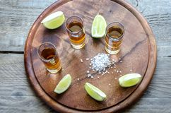 Glasses of tequila on the wooden board Stock Image