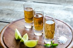 Glasses of tequila on the wooden board Royalty Free Stock Photography