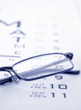 Glasses on test chart Stock Photos