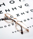 Glasses on test chart Royalty Free Stock Photo