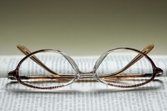 Glasses on the text Royalty Free Stock Photography