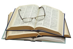 Glasses on three open books. Glasses on a stack of three open books on white background, saved with clipping path Royalty Free Stock Photo