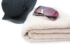 Glasses, a towel and a panama Beach Holiday. Royalty Free Stock Photos