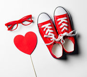 Glasses, toy and gumshoes Royalty Free Stock Image