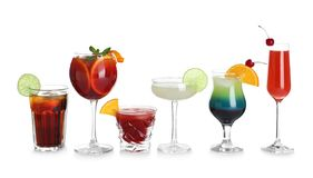 Glasses of traditional alcoholic cocktails on white. Background stock images