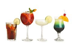 Glasses of traditional alcoholic cocktails on white. Background royalty free stock image