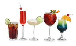 Glasses of traditional alcoholic cocktails on white. Background royalty free stock photos