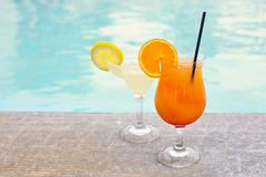 Glasses of tropical cocktail on poolside. Close up Royalty Free Stock Images