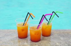 Glasses of tropical cocktail on poolside. Close up Royalty Free Stock Image
