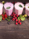 Glasses of various fresh berries smoothies Royalty Free Stock Photos