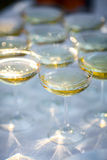 Glasses of vine. Nine glasses of wine set on table in the restaurant . Shallow depth of field, very soft image Stock Photos