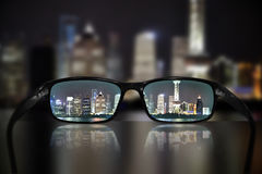 Glasses, vision concept, Shanghai. Glasses and Shanghai panorama - great for topics like vision, business concept or eyesight problems Royalty Free Stock Image