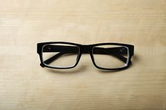 Glasses for vision. On a wooden background. Copy space Royalty Free Stock Image