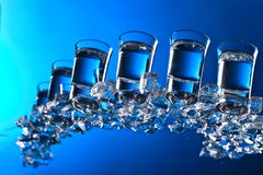 Glasses of vodka with ice. View from the bottom Stock Photography