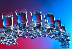 Glasses of vodka . Glasses of vodka with ice. View from the bottom Stock Photo