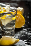 Glasses with vodka and lemon. Royalty Free Stock Image