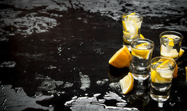 Glasses with vodka and lemon. Royalty Free Stock Photo