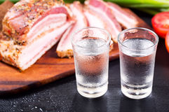 Glasses of vodka with snack Royalty Free Stock Photos