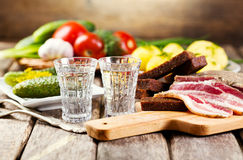 Glasses of vodka with traditional  snack Royalty Free Stock Photo