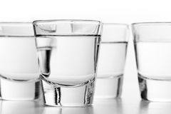 Glasses of vodka on white background. Alcohol Royalty Free Stock Photo