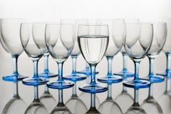 Glasses of Water. Glasses, one Full of Water Stock Photos