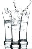 Glasses with water. On the white background Royalty Free Stock Images