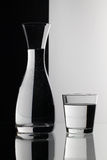 Glasses of water on the black and white background Stock Image