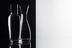 Glasses of water on the black and white background Stock Photos
