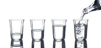 Glasses with water and a bottle Royalty Free Stock Image