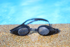 Glasses of water. At the edge of the pool Stock Images