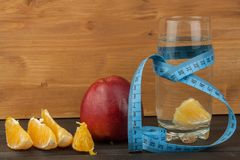 Glasses of water and fruit. Food for weight reduction. Diet program. Controlled diet. Healthy diet for athletes. Royalty Free Stock Photo