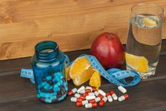 Glasses of water and fruit. Supplements and vitamins for the diet program. Food for weight reduction Stock Photography