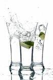 Glasses with water and lime. On the white background Royalty Free Stock Photography