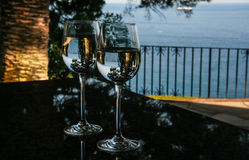 Glasses, water and pines stock photography